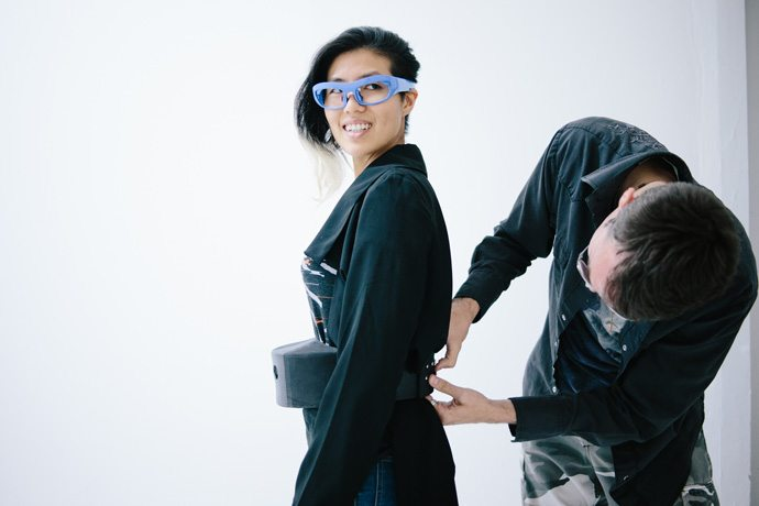 """The glasses at Hussein Chalayan's runway show on Sept. 30, 2016, are connected to a wearer's belt. The belt includes an Intel Compute Stick, a tiny computing device the size of a pack of gum that captures the biometric data and translates it by projecting visualizations interpreting the wearer's """"stress level"""" onto a wall via a small Pico projector. Paris Fashion Week's Spring/Summer 2017 event runs Sept. 27-Oct. 5, 2016. (Credit: Intel Corporation)"""